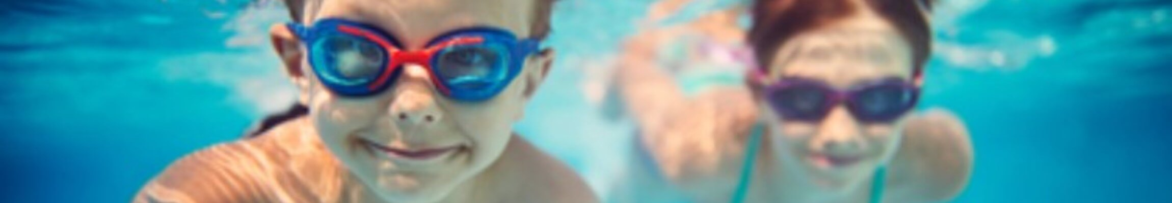 Kids with goggles swimming underwater